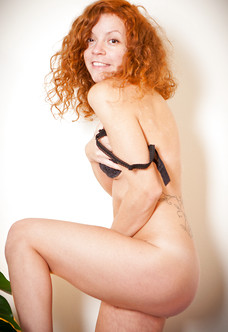 Cute hairy redhead amateur stripping