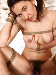 Busty brunette Kristina tied up with rope