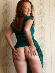 Redhead Ginger shows trimmed muff