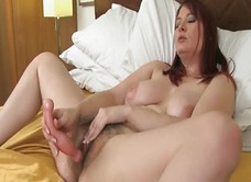 Busty Alabama is fucking hairy pussy with dildo
