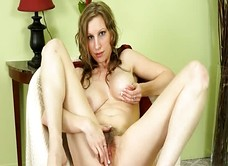 Busty Sausha Parker shows hairy pussy