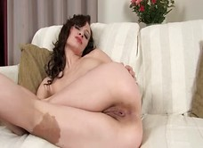 Natural brunette gaping her hairy pussy