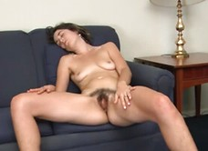 Penelope rubs her hairy pussy for you